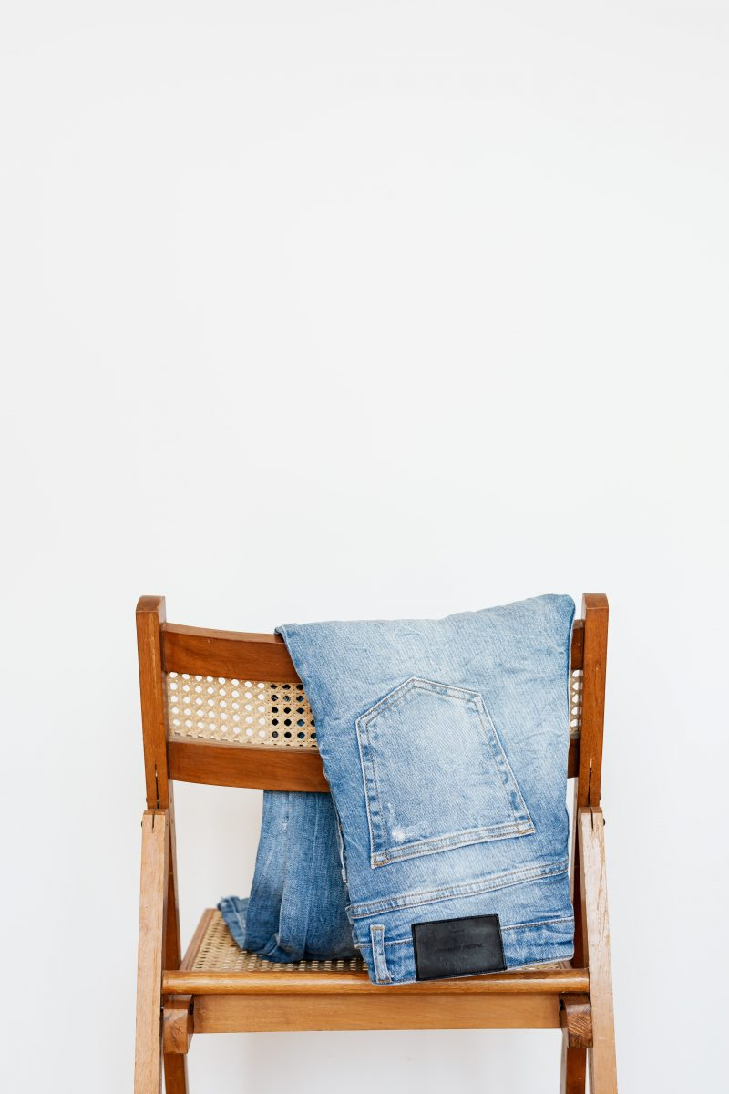 Gab With Me Brands That Recycle Clothes Blog Post Image of Blue Jeans Draped Over Chair